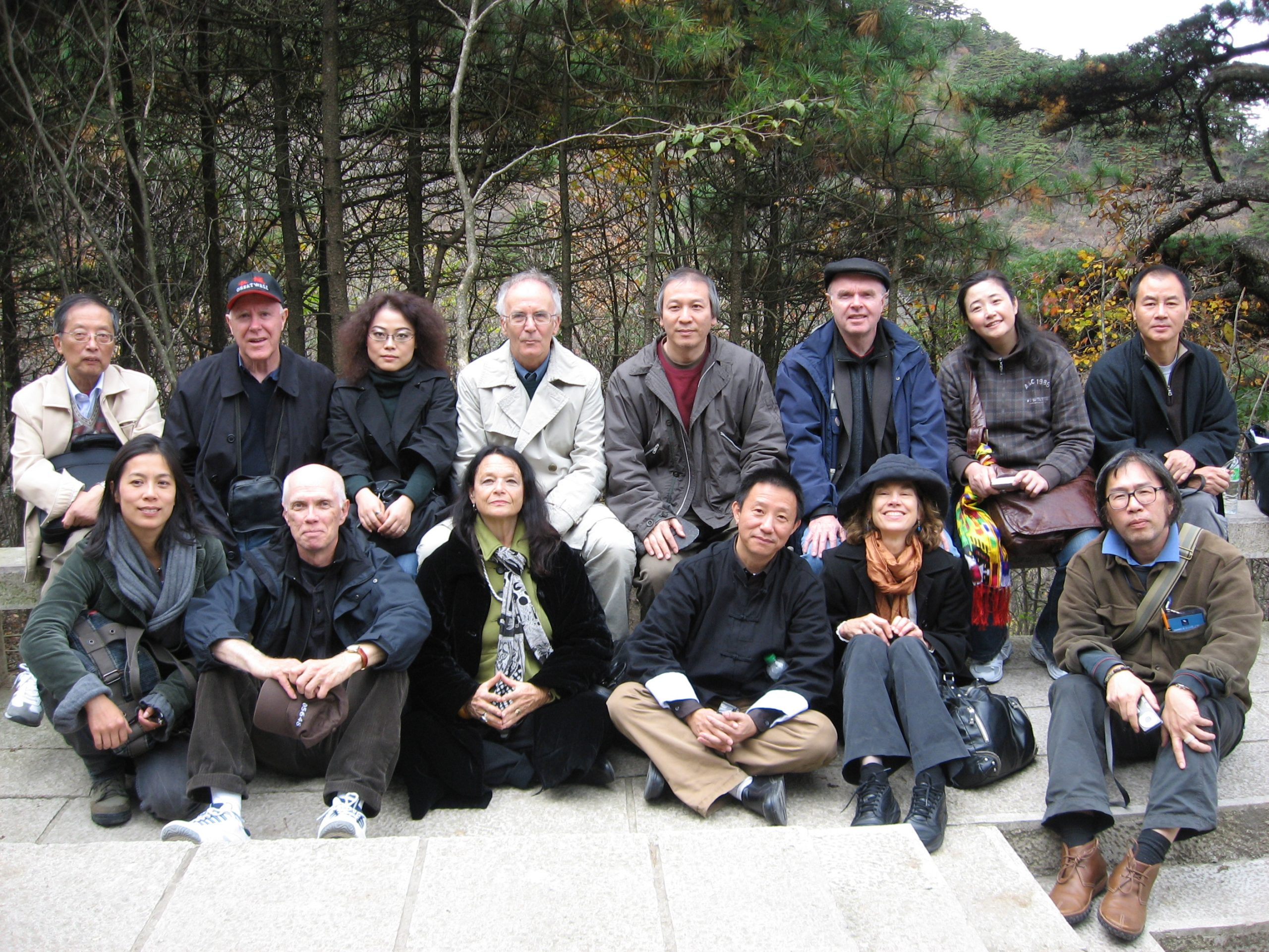 Anne in China with poets taking part in the 2008 Pamirs Academy international poetry conference. Back row (from l.): Zhang Ziching (professor and translator of Allen Ginsberg), Robert Hass, Liang Li-zhen (interpreter), Tomaž Šalamun, Song Lin, Tim Lilburn, Lan Lan, Wang Jiaxin; front row: unnamed artist girlfriend of Xi Chuan, Ron Padgett, Anne Waldman, Ouyang Jianghe, Brenda Hillman, Xi Chuan. Missing: Juan Carlos Mestre and Yu Jian, who possibly took the photo.
